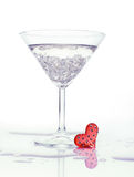 Love coctail. Martini glass and red heart, still life Royalty Free Stock Image