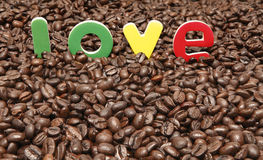 Love coffee. Concept with organic fresh beans background Royalty Free Stock Images
