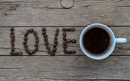 LOVE coffee beans on wooden background Royalty Free Stock Photography