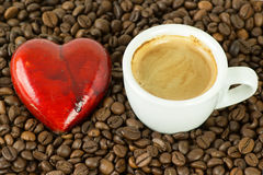 Love Coffee. Cup of coffee along with a heart and coffee beans stock photos