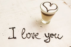 Love coffee cup and handwriting. I love you. Creative card Royalty Free Stock Image