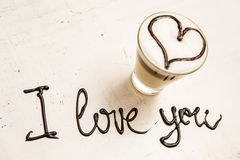 Love coffee cup and handwriting. I love you. Creative card Stock Image