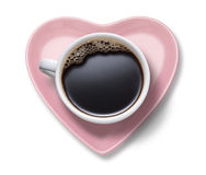 Love Coffee Cup Heart. A coffee cup full of black coffee on a pink heart shaped saucer on a white background Royalty Free Stock Image