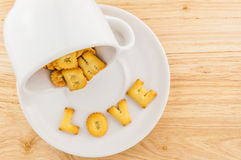 Love - coffee cup with letter cracker Stock Photos