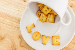 Love - coffee cup with letter cracker Royalty Free Stock Images