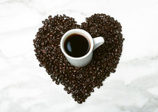 Coffee beans in the shape of a heart Royalty Free Stock Images