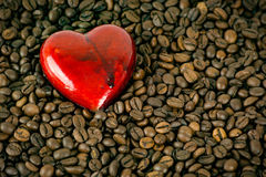 Love Coffee. A heart along with coffee beans royalty free stock images