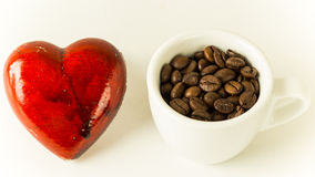Love Coffee. A heart along with a cup of coffee beans stock image