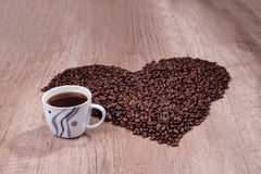 In love with coffee. Heart made from beans Stock Photography