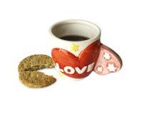 Love coffee mug with cookies. Love letter on ceramic coffee mug with cookies Stock Photos
