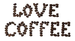 Love coffee sign lined coffee beans. Isolated on white phrase love coffee lined with coffee beans Royalty Free Stock Image
