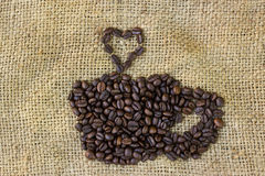 Love coffee symbols made of coffee beans on sack Royalty Free Stock Images