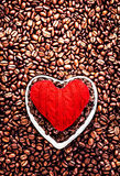 Love Coffee at Valentine's Day. Roasted Coffee Beans with Red He Royalty Free Stock Image