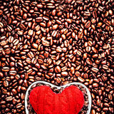 Love Coffee at Valentine's Day. Roasted Coffee Beans with Red He Royalty Free Stock Photography