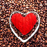 Love Coffee at Valentine's Day. Roasted Coffee Beans with Red He Stock Photos