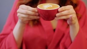 Love coffee woman red drink cappuccino cup delight. Love of coffee. Woman in red drinking hot foamy cappuccino in red cup. Delight and tasty pleasure stock video footage