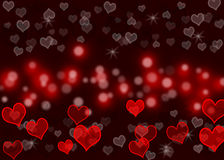 Love. Color glowing hearts with red bokeh  background wall paper Royalty Free Stock Image