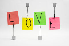 Love on color notes. Word love written on color notes Royalty Free Stock Images