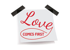 Love comes first. Love note on a paper Stock Photo