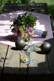 Love and commitment. Wedding bouquet on table next to shackled dumbbell weights, love and commitment concept Royalty Free Stock Photo