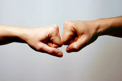 Love and complicity. Man and Woman hands punches the one in front of the other. Indicating romantic love and complicity stock photography
