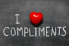 Love compliments. I love compliments phrase handwritten on school blackboard Royalty Free Stock Images