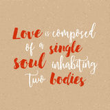 Love is composed of a single soul inhabiting two bodies - Inspirational quote handwritten with black ink and brush. Good for posters, t-shirts, prints, cards Royalty Free Stock Photos