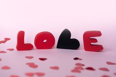 Love composition on pink background. Valentines day greeting card with love word stock photo