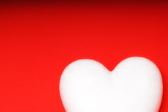 Love concept. With white heart on red background Royalty Free Stock Photos