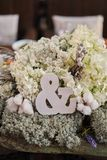 Love concept of ampersand sign to symbolise relationship wedding decoration, ampersand symbol in a flower arrangement royalty free stock photography