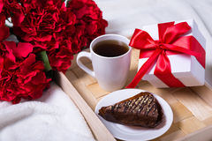 Love concept - breakfast with cake, tea and little gift on woode Stock Photo