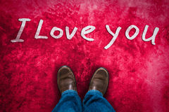 Love concept with Brown leather shoes. And hand drawn text  I Love You . red pink grunge background Royalty Free Stock Images