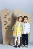 Love concept. Couple of kids. boy and girl with  cardboard town Stock Photo