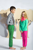 Love concept. Couple of kids. boy gives a girl cardboard flowers Stock Image