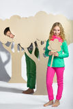 Love concept. Couple of kids. boy gives a girl cardboard flowers Stock Images