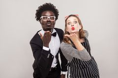 Love concept. Couple send air kisses at camera Royalty Free Stock Photography