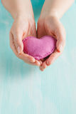 Love concept. Female holding a hearts in hands. Stock Photo