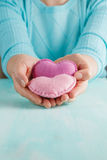Love concept. Female holding a hearts in hands. Stock Photography