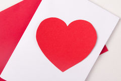 Love concept - handmade card with red paper heart Royalty Free Stock Image