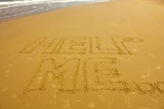 Love concept handwritten on sand Stock Image