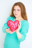 Love concept. Happy red hair woman holding valentine heart. Stock Image