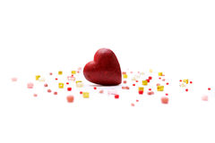 Love concept with heart. Red heart and bisser on white background Royalty Free Stock Image