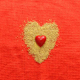 Love concept with heart. Romantic red background with heart, bisser and textile Stock Photos