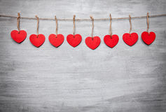 Love concept. Hearts hanging on a string. Shot on grey background stock photography