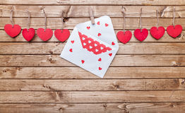 Love concept. Hearts and love letter hanging on a string Stock Photos