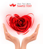 Love concept  holding a red heart in hands Royalty Free Stock Photos