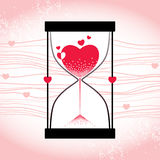Love concept with hourglass and decreasing sand on the striped pink background Stock Photos