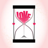 Love concept with hourglass and decreasing sand on the textured pink background Royalty Free Stock Photos