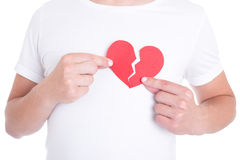 Love concept - man holding two halfs of broken heart  Stock Photo