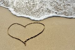 Love concept - one heart drawn on sand beach Stock Photography